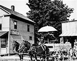 1900s OLD HORSE DRAWN FARM WAGON AT GENERAL STORE AND POST OFFICE COURTNEY MISSOURI USA