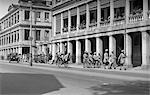 1920s 1930s STREET SCENE CHINA HONG KONG RICKSHAW GROUP OF INDIAN SOLDIERS WITH RIFLES MARCHING BY