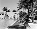 SWIMMING POOL NAUTILUS HOTEL MIAMI BEACH PALM TREES BATHING SUIT 1940s