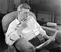 1930s MAN SITTING CHAIR READING NEWSPAPER SMOKING PIPE    Stock Photo - Premium Rights-Managednull, Code: 846-02796575