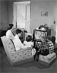 1950s FAMILY WATCHING TELEVISION MOTHER FATHER THREE CHILDREN