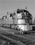 1950s STREAMLINED BURLINGTON ROUTE DIESEL TRAIN LOCOMOTIVE AT STATION