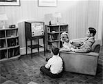 1940s 1950s FATHER WITH TWO CHILDREN WATCHING TELEVISION