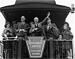 1930s GROUP FAMILY MEN WOMEN CHILDREN ON PLATFORM OF CABOOSE OF TRAIN SENIOR MAN WAVING    Stock Photo - Premium Rights-Managed, Artist: ClassicStock, Code: 846-02796733