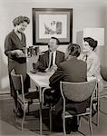1950s CARD PARTY OF 2 COUPLES WITH WOMAN SERVING DRINKS    Stock Photo - Premium Rights-Managed, Artist: ClassicStock, Code: 846-02796799