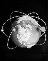 1960s MODEL OF EARTH WITH THREE SATELLITES IN ORBIT    Stock Photo - Premium Rights-Managednull, Code: 846-02796933