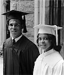 1970s BLACK COUPLE PORTRAIT WEARING GRADUATION GOWNS