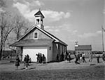 1940s 1950s ELEMENTARY SCHOOL CHILDREN AT RECESS AT RURAL ONE ROOM SCHOOLHOUSE