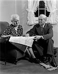 1950s ELDERLY COUPLE LOOKING AT MAP    Stock Photo - Premium Rights-Managed, Artist: ClassicStock, Code: 846-02797223