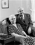 1950s ELDERLY COUPLE SITTING ON COUCH SMILING    Stock Photo - Premium Rights-Managed, Artist: ClassicStock, Code: 846-02797224