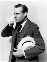sweaty businessman - 1930s MAN IN SUIT HOLDING HAT WIPING FACE WITH HANDKERCHIEF    Stock Photo - Premium Rights-Managednull, Code: 846-02797275