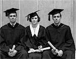 1930s 1940s THREE UNIVERSITY STUDENTS CAP GOWN GRADUATION ROBES 2 MEN WOMAN STUDENTS HOLDING DIPLOMAS