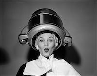 retro beauty salon images - 1950s WOMAN UNDER HAIR DRYER WITH TOWEL ON SHOULDERS AND HAIR NET    Stock Photo - Premium Rights-Managednull, Code: 846-02797532
