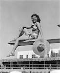 1930s 1940s WOMAN HOLDING HAT POSING DIVING BOARD SWIM SUIT POOL TRAVEL VACATION SWIMMING HOTEL MIAMI FLORIDA