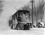 1930s 1940s SPECIAL TROLLY CAR BRUSHING SNOW OFF TRACKS ON CITY STREET IN WINTER PHILADELPHIA PENNSYLVANIA USA