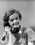 1930s TEEN GIRL SMILING BRUNETTE PRINT DRESS TALKING ON TELEPHONE
