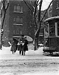 1940s ONE MAN TWO WOMEN WALKING IN SNOW WINTER WITH UMBRELLA PACKAGES 43rd & SPRUCE STREET CITY PHILADELPHIA TROLLEY CAR