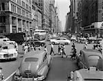 1940s 1950s STREET SCENE CROWDS TRAFFIC INTERSECTION FIFTH AVENUE & 14 STREET MANHATTAN NY NEW YORK CITY