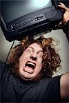 Man Throwing Television    Stock Photo - Premium Rights-Managed, Artist: Nathan Jones, Code: 700-02798081