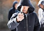 Man threatening with pocket knife Stock Photo - Premium Royalty-Free, Artist: Blue Images Online, Code: 635-02800002