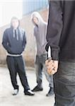 Two men being confronted by man with knife Stock Photo - Premium Royalty-Free, Artist: RW Photographic, Code: 635-02800003