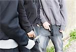 Men holding guns and knife Stock Photo - Premium Royalty-Free, Artist: Westend61, Code: 635-02800009