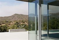 rich lifestyle - Exterior of glass walls of modern house Stock Photo - Premium Royalty-Freenull, Code: 635-02800121