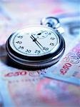Close up of stopwatch on 50 pound notes Stock Photo - Premium Royalty-Free, Artist: iRepublic, Code: 635-02800347