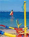 Prahu boat and windsurfer, Sanur Beach, Bali, Indonesia, Southeast Asia, Asia
