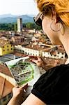 Woman Reading Map, Lucca, Lucca Province, Tuscany, Italy