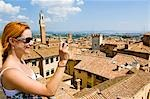 Woman Taking Photograph, Siena, Siena Province, Tuscany, Italy