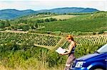 Lost Woman Reading Road Map, Chianti, Tuscany, Italy    Stock Photo - Premium Rights-Managed, Artist: Chris Hendrickson, Code: 700-02828620