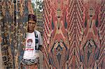 Portrait of a man and ikat design, Sumba (Soemba), Lesser Sundas, Indonesia, Southeast Asia, Asia