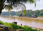 Logging barge on the Kinabatangan River, Eastern Sabah, island of Borneo, Malaysia    Stock Photo - Premium Rights-Managed, Artist: Robert Harding Images, Code: 841-02832451