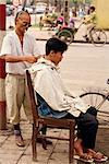 A street hair stylist on the pavement in the centre of the city of Hanoi, Vietnam, Indochina, Southeast Asia, Asia    Stock Photo - Premium Rights-Managed, Artist: Robert Harding Images, Code: 841-02832845