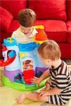 Boys Sitting on Floor Playing with Toys Stock Photo - Premium Rights-Managed, Artist: SimplyMui, Code: 700-02833641