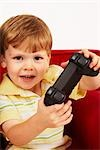 Close-up of Boy Playing Video Game Stock Photo - Premium Rights-Managed, Artist: SimplyMui, Code: 700-02833651