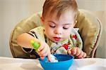 Boy with Down Syndrom Sitting in High Chair, Eating Stock Photo - Premium Rights-Managed, Artist: SimplyMui, Code: 700-02833655
