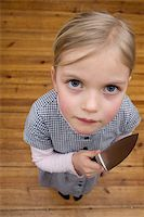 A young girl holding a sharp knife menacingly Stock Photo - Premium Royalty-Freenull, Code: 653-02834202