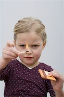 A young girl playing with matches Stock Photo - Premium Royalty-Freenull, Code: 653-02834212