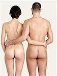 Rear view of a naked couple standing side by side