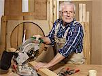 A man sawing wood in a workshop Stock Photo - Premium Royalty-Free, Artist: Blend Images, Code: 653-02835080