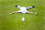 A golfer lying on a putting green behind an arrow of golf balls Stock Photo - Premium Royalty-Free, Artist: Aflo Sport               , Code: 653-02835665