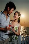 Young couple on beach at sunset with martini drinks Stock Photo - Premium Rights-Managed, Artist: Asia Images, Code: 849-02860377