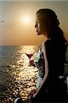 Young woman looking out over the ocean at sunset Stock Photo - Premium Rights-Managed, Artist: Asia Images, Code: 849-02860474