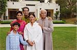 family in front of home Stock Photo - Premium Rights-Managed, Artist: Asia Images, Code: 849-02862153