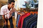man shopping for shirts