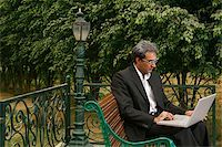 man with laptop on bench Stock Photo - Premium Rights-Managednull, Code: 849-02862256