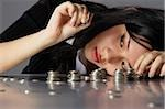 counting coins Stock Photo - Premium Rights-Managed, Artist: Asia Images, Code: 849-02863053