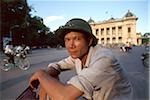Vietnam, Hanoi, pedicab driver in front of Municipal Theatre. Stock Photo - Premium Rights-Managed, Artist: Asia Images, Code: 849-02865139